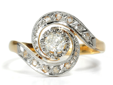 Edwardian Twirls in an 18k Diamond Ring