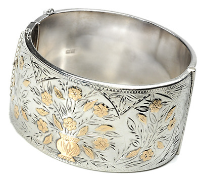 A Golden Vase of Flowers on a Silver Bangle