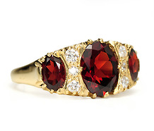 Homage in a Garnet & Diamond Ring