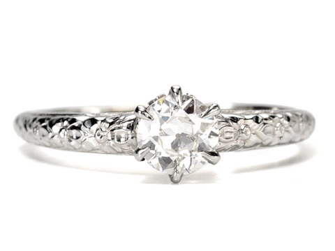 Blossoms in a Solitaire Diamond Engagement Ring