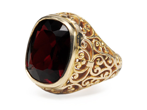 A Statement: Signed C.D. Peacock Garnet Ring