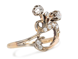 Whiplash Curve in an Art Nouveau Diamond Ring