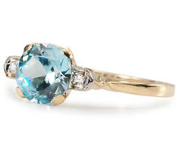 Charm in a Zircon Diamond Ring