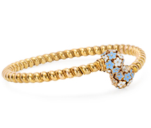 With a Twist: Enamel Gold Flower Bracelet