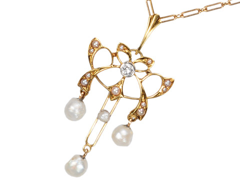 Delicacy Unfolded: Antique Pearl Pendant