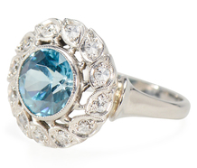 Blue Notes of a Zircon Diamond Halo Ring