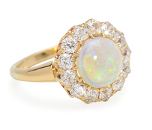Flight of Fancy in an Opal Halo Ring