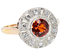 Sunrise in a Spessartite Garnet Halo Ring