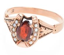 Luck Has It - Horseshoe Garnet Ring